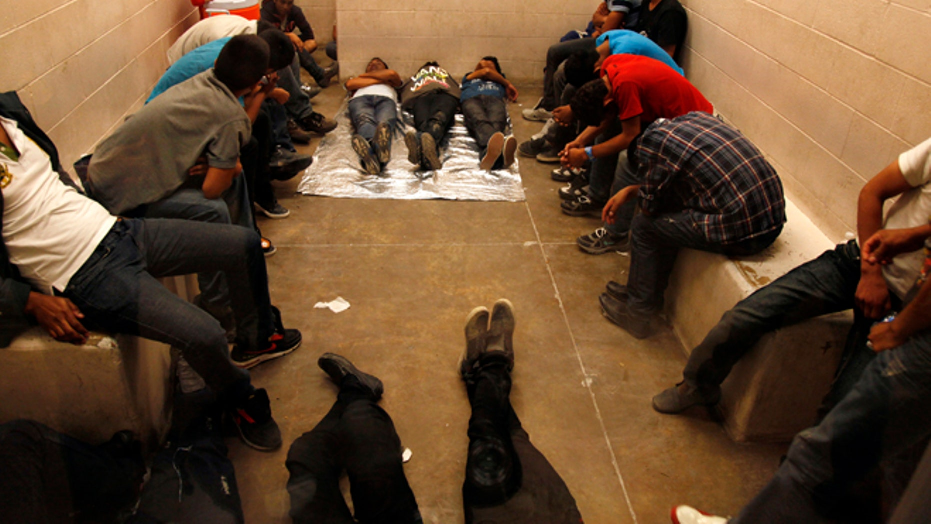 MCALLEN, TX. --TUESDAY,  JULY 15, 2014 -- Immigrants who have been detained while crossing the border  are held inside the McAllen Border Patrol Station in McAllen, Texas, Tuesday July 15, 2014.   More than 350 detainees were being held  on Tuesday, July 15, 2014, at the station.  A solution for the growing crisis of tens of thousands of unaccompanied children showing up at the U.S.-Mexico border is looking increasingly elusive with three weeks left before Congress leaves Washington for an annual August recess.    (AP Photo/Los Angeles Times, Rick Loomis, Pool)
