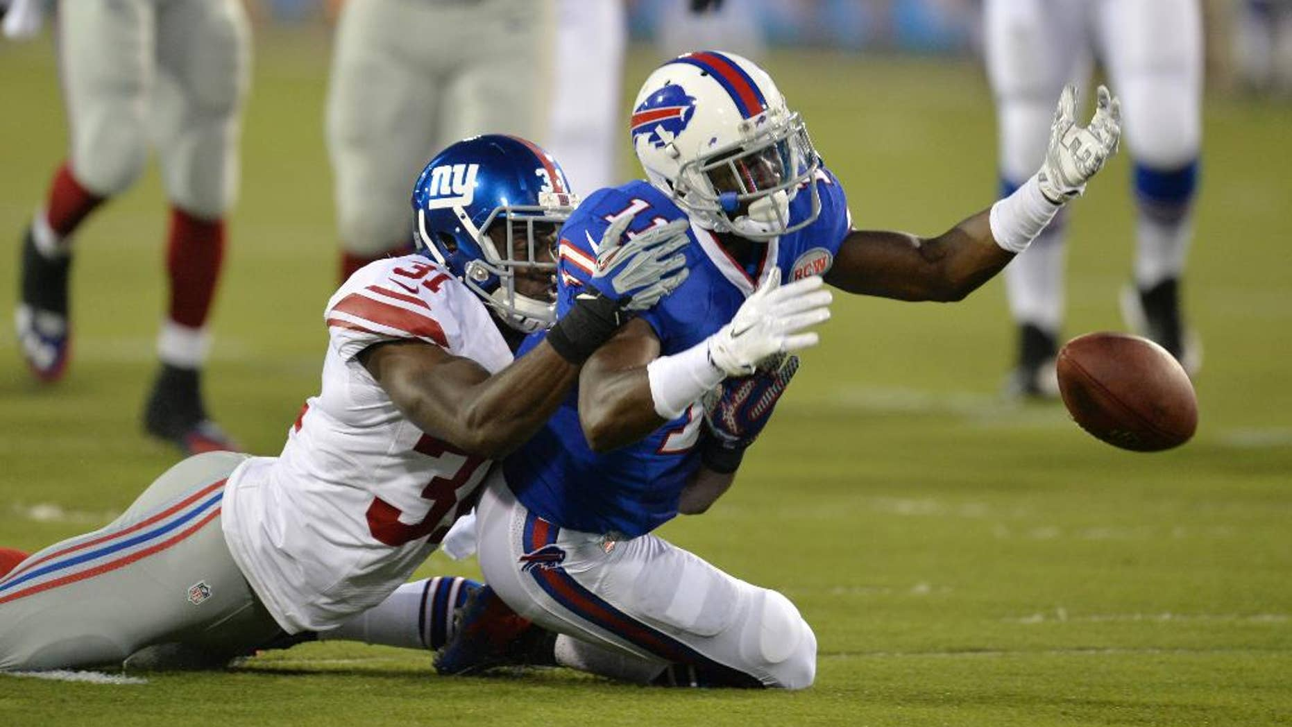 Buffalo Bills wide receiver T.J. Graham (11) can't reach the ball on a pass under pressure from New York Giants cornerback Zack Bowman (31) in the second quarter of the Pro Football Hall of Fame exhibition NFL football game Sunday, Aug. 3, 2014, in Canton, Ohio. (AP Photo/David Richard)