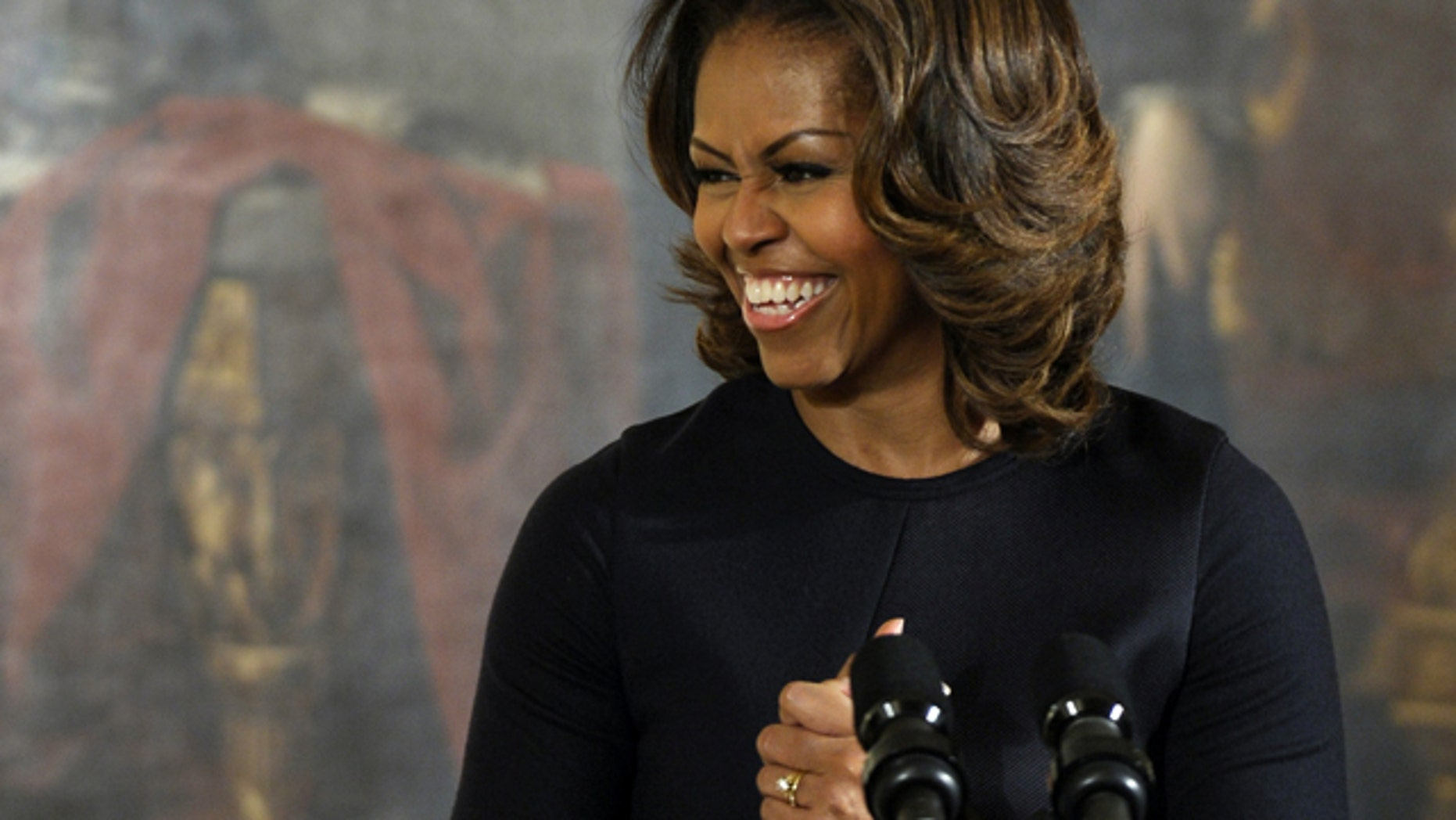 First lady Michelle Obama speaks in the East Room of the White House in Washington, Friday, Nov. 22, 2013, before presenting the Presidentâs Committee on the Arts and the Humanities (PCAH) National Arts and Humanities Youth Program Awards. (AP Photo/Susan Walsh)
