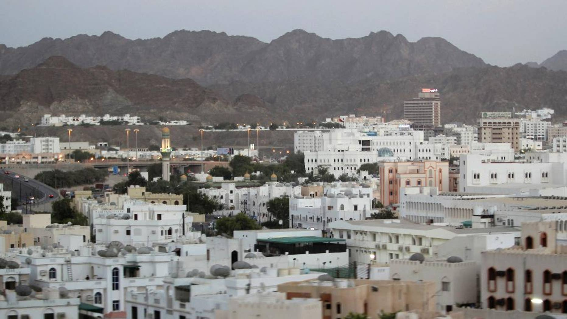 FILE -- In this Sept. 15, 2010 file photo shows a general view of the city, in Muscat, Oman. A new report released Wednesday, July 13, 2016 by Human Rights Watch alleges that foreign maids working in Oman face abuse and conditions that near slavery. The report, based on interviews its researchers conducted with 59 female migrant workers in the sultanate, said some recounted being beaten, verbally abused, denied fair pay and working as much as 20-hour days. (AP Photo/Kamran Jebreili, File)