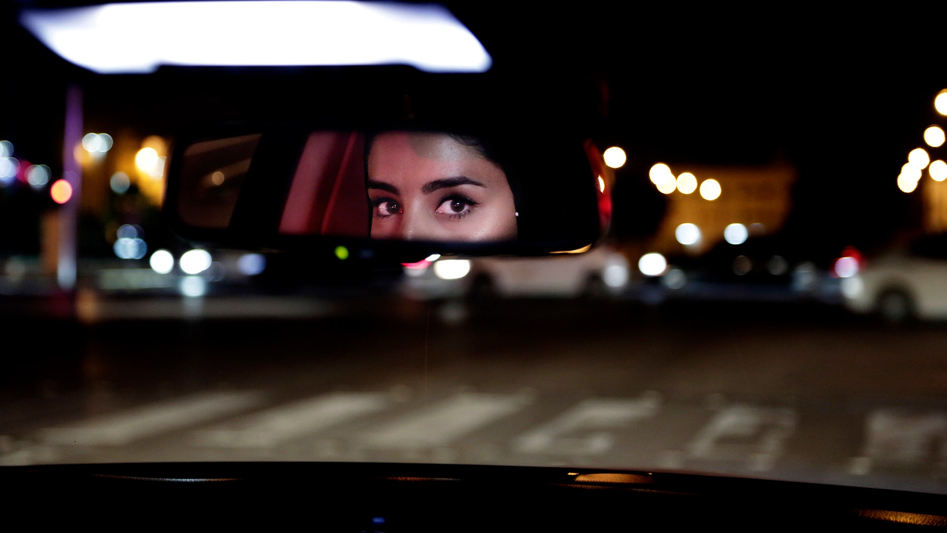 FILE - In this Sunday, June 24, 2018 file photo, Hessah al-Ajaji drives her car down the capital's busy Tahlia Street after midnight for the first time, in Riyadh, Saudi Arabia. Saudi women are driving freely for the first time after years of risking arrest if they dared to get behind the wheel.  (AP Photo/Nariman El-Mofty, File)