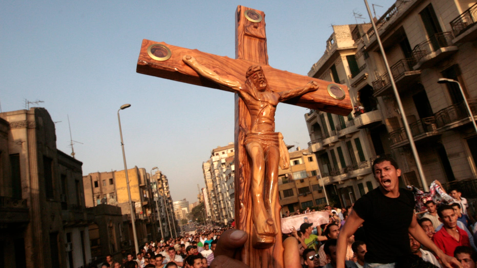 Angry Egyptian Christians protest outside St. Mark's Cathedral against the military ruling council in Cairo Egypt, Monday, Oct. 10, 2011 a day after at least 24 people were killed when Christians, angered by a recent church attack, clashed Sunday night with Muslims and security forces outside the state television building in central Cairo.