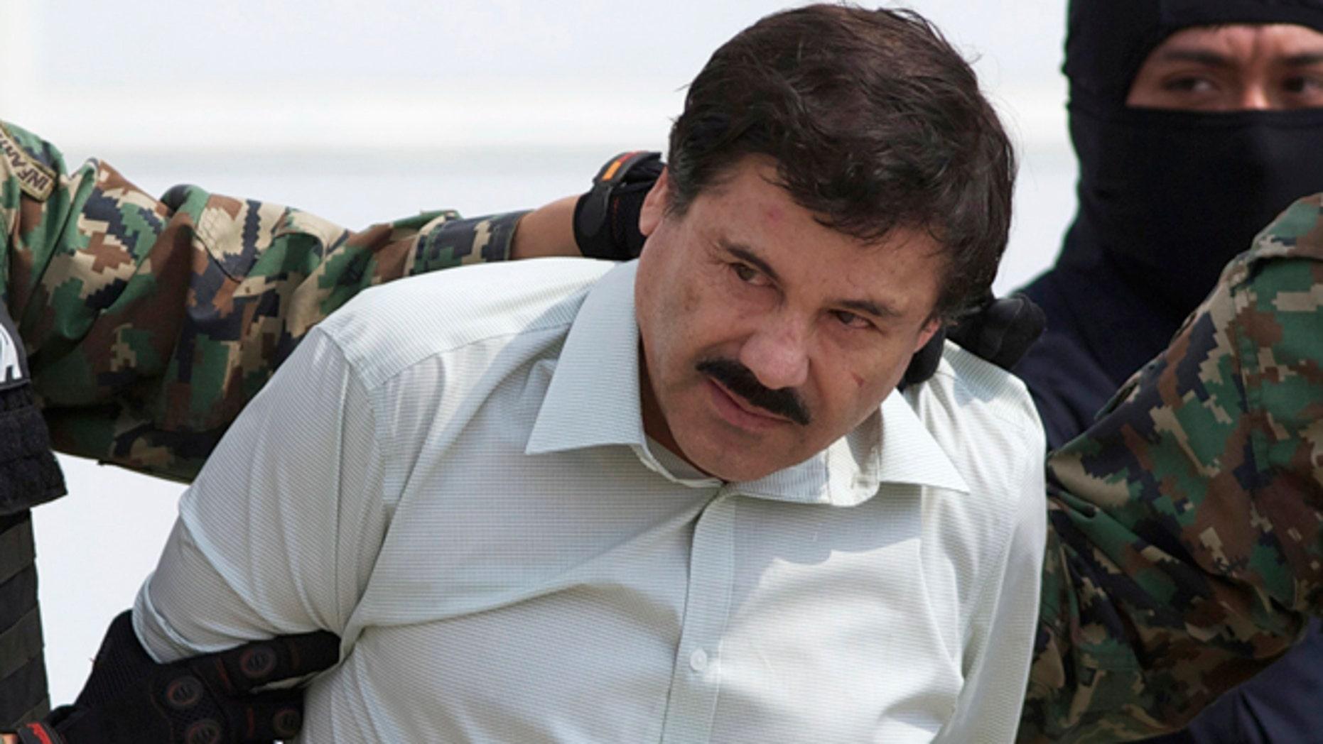 "Joaquin ""El Chapo"" Guzman escorted to a helicopter in Mexico City on Feb. 22, 2014."