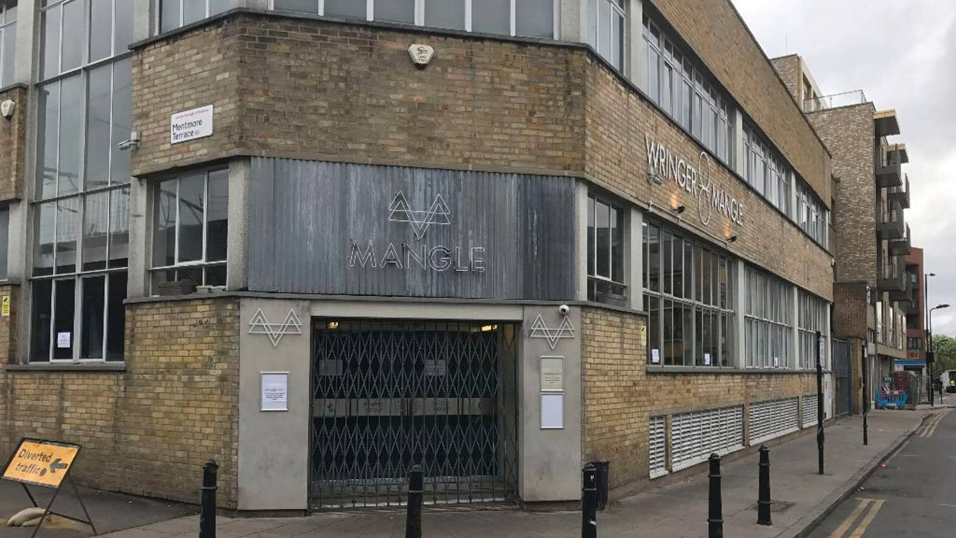 General view of the Mangle nightclub in Dalston, east London on Monday April 17, 2017. London police are investigating an acid attack at a London club that led to a mass evacuation with 12 people injured. Police said Monday April 17, 2017 that 12 people were treated at hospitals for burns. None of the injuries were said to be life-threatening.   (Jack Hard/PA via AP)