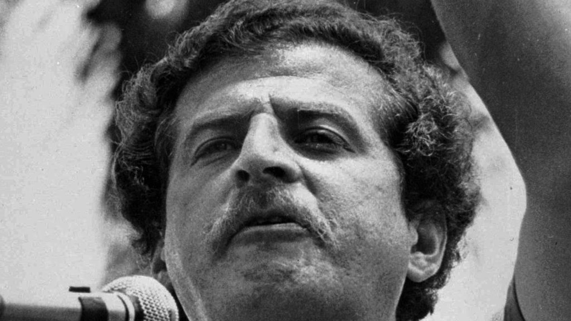 FILE - In this 1982 file photo, Luis Carlos Galan speaks at a political rally in Colombia. Retired Colombian general Miguel Maza has been found guilty by the Colombian Supreme Court on Thursday, Nov. 24, 2016, and sentenced to 30 years in prison for his role in the 1989 assassination of Galan, the top presidential contender a the time. (AP Photo/File)