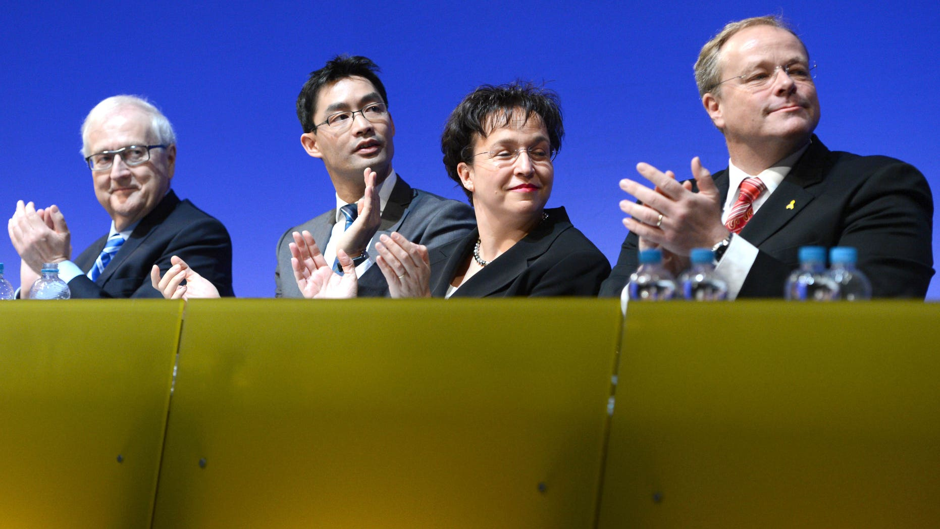 From left: Free Democratic Party (FDP) faction leader Rainer  Bruederle.  German economy minister, vice-chancellor and party chairman,  Philipp Roesler, vice-chairwoman of the party, Birgit Homburger and development minister Dirk Niebel attend a meeting of the FDP in Stuttgart, southern Germany, Sunday, Jan. 6, 2013. Germany's embattled vice chancellor is battling to quell speculation about his leadership of the country's junior governing party, whose dire poll ratings are a complicating factor in Chancellor Angela Merkel's bid for re-election.  Philipp Roesler, who's also Germany's economy minister, appealed to his pro-market Free Democratic Party on Sunday to show unity ahead of a state election in his home region of Lower Saxony on Jan. 20, an important political test ahead of national elections in September.  (AP Photo/dpa/ Bernd Weißbrod)