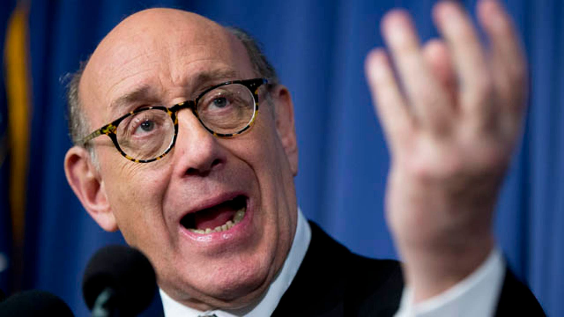FILE - In this Monday, June 30, 2014, file photo, Kenneth Feinberg, the independent claims administrator for the General Motors Ignition Compensation Program, announces the details of the program during a news conference at the National Press Club in Washington. (AP Photo/Manuel Balce Ceneta)