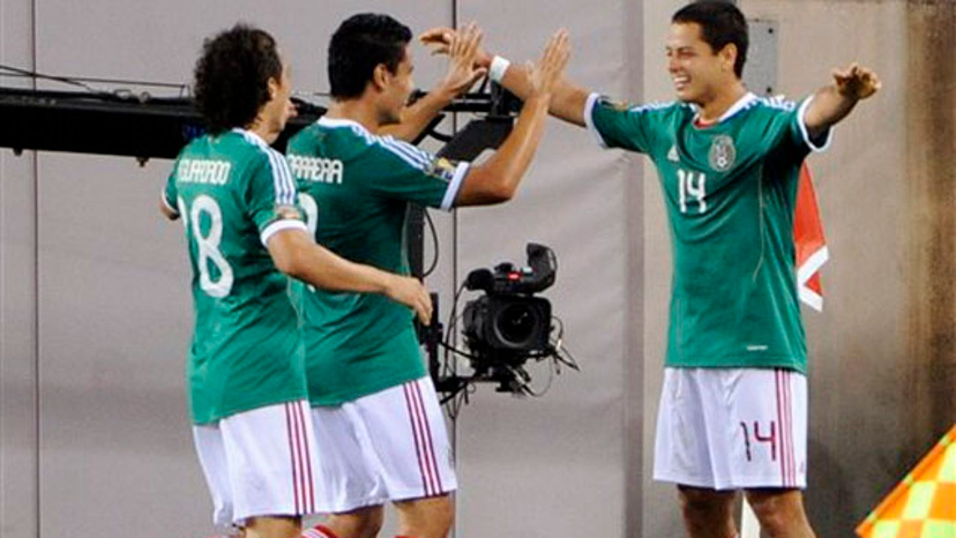 Mexico's Javier Hernandez, right, celebrates his goal with teammates Pablo Barrera, center, and Andres Guardado, left, during the second half of a CONCACAF Gold Cup quarterfinal soccer match against Guatemala, Saturday, June 18, 2011, at New Meadowlands Stadium in East Rutherford, N.J. Mexico won 2-1.