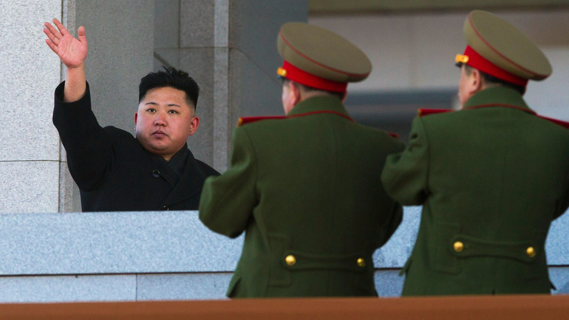 North Korean leader Kim Jong Un waves at Kumsusan Memorial Palace in Pyongyang after reviewing a parade of thousands of soldiers and commemorating the 70th birthday of his late father Kim Jong Il. (AP Photo/David Guttenfelder, File)