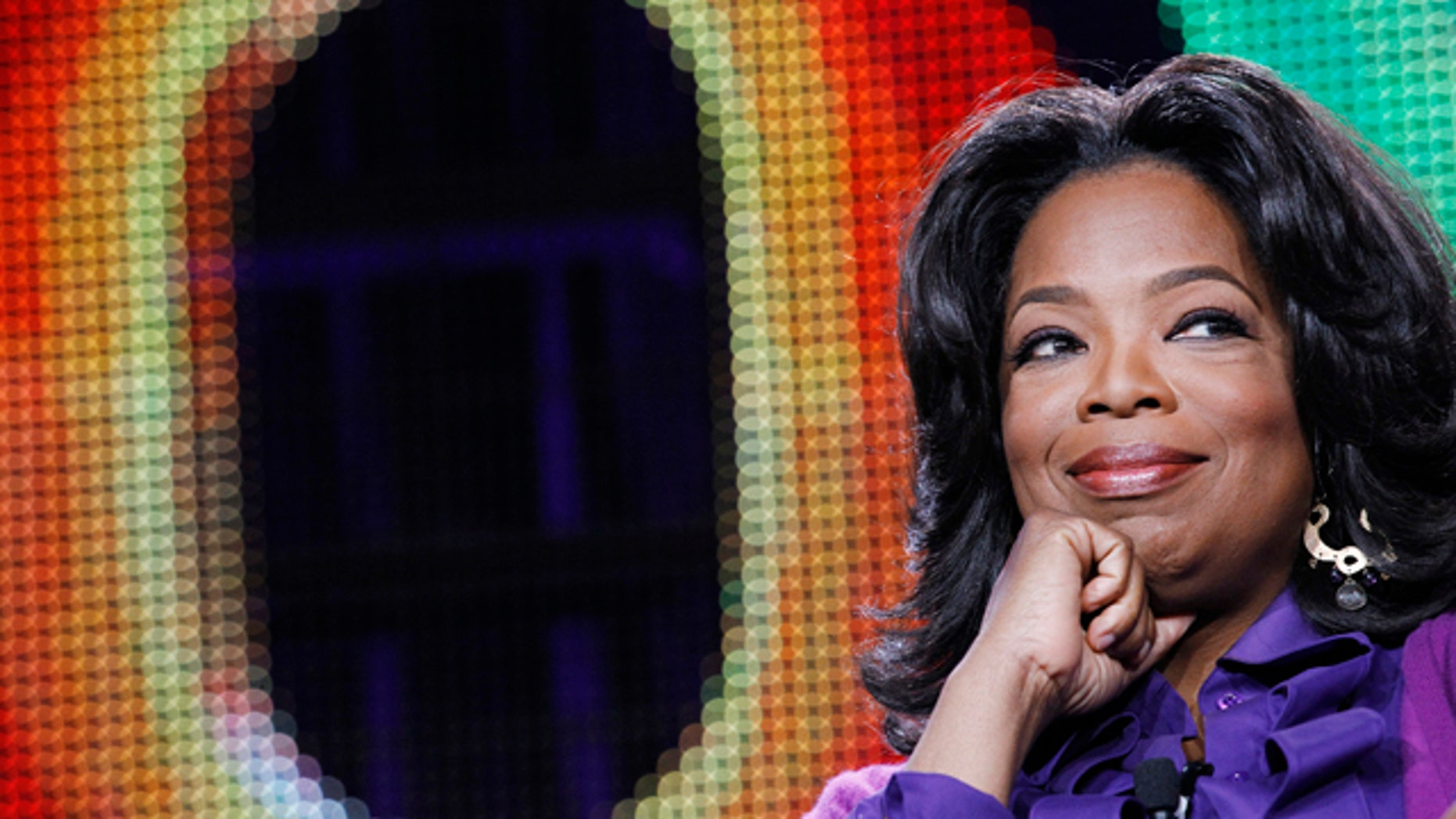 Oprah Winfrey attends a panel during the Oprah Winfrey Network (OWN) Television Critics Association winter press tour in Pasadena, California January 6, 2011.  REUTERS/Mario Anzuoni (UNITED STATES - Tags: ENTERTAINMENT)