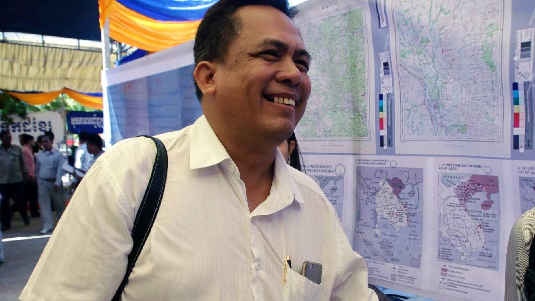 FILE - In this June 4, 2016, file photo, prominent political analyst Kem Ley smiles as he celebrated the 67th anniversary to commemorate the Kampuchea Krom territory's return to Vietnam by the French government, at Chroy Changvar, in Phnom Penh, Cambodia. A Cambodian man has confessed in court Wednesday to killing Kem Ley over an unpaid loan, but the victim's family says he's a scapegoat in a political assassination. (AP Photo/Heng Sinith, File)