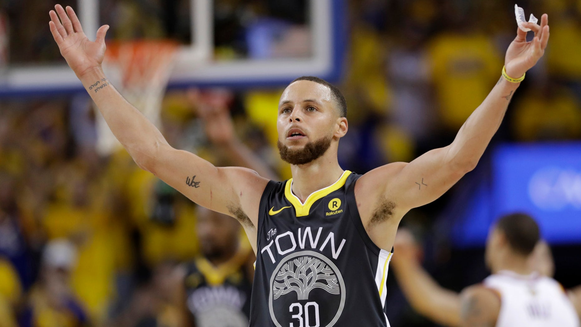 June 3: Golden State Warriors guard Stephen Curry (30) celebrates during the second half of Game 2.