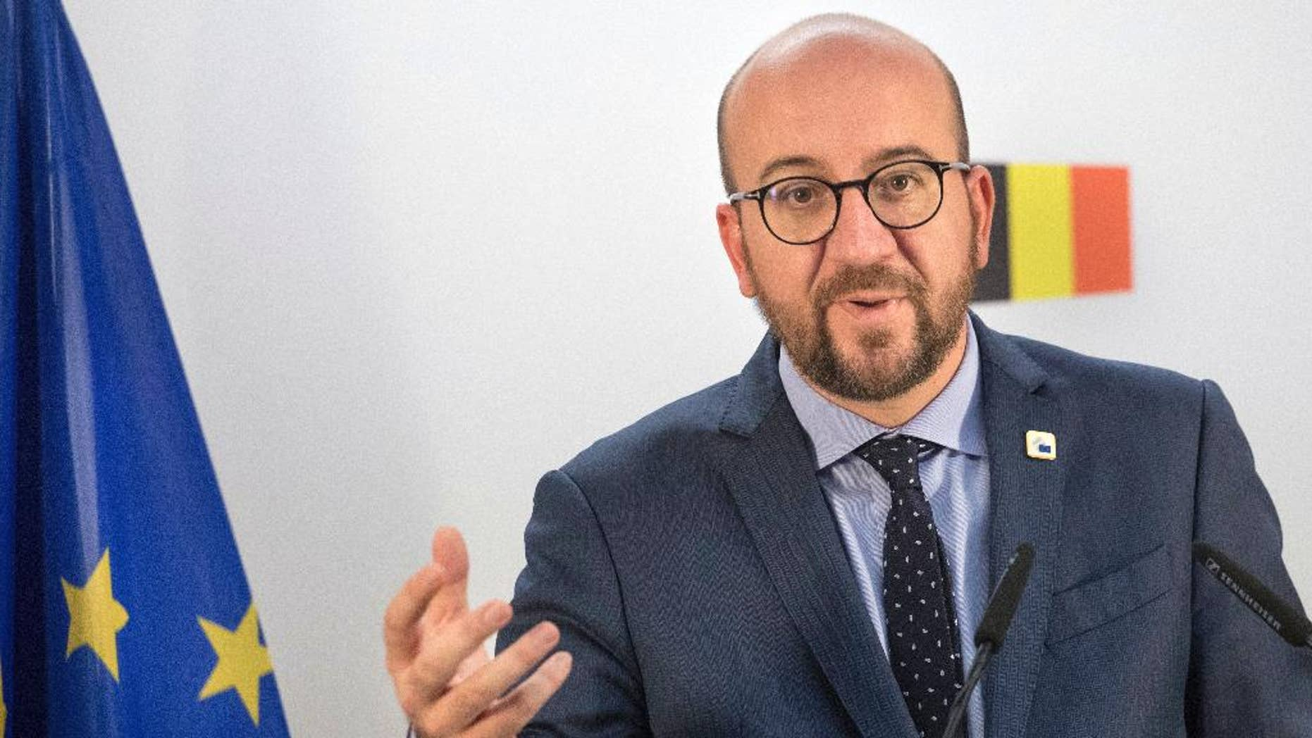 Belgian Prime Minister Charles Michel holds a press conference on the second day of the EU summit in Brussels, Friday, Oct. 21, 2016. The European Union was scrambling Friday to salvage a massive free trade deal with Canada that was being held up by a small region in Belgium. (AP Photo/Olivier Matthys)