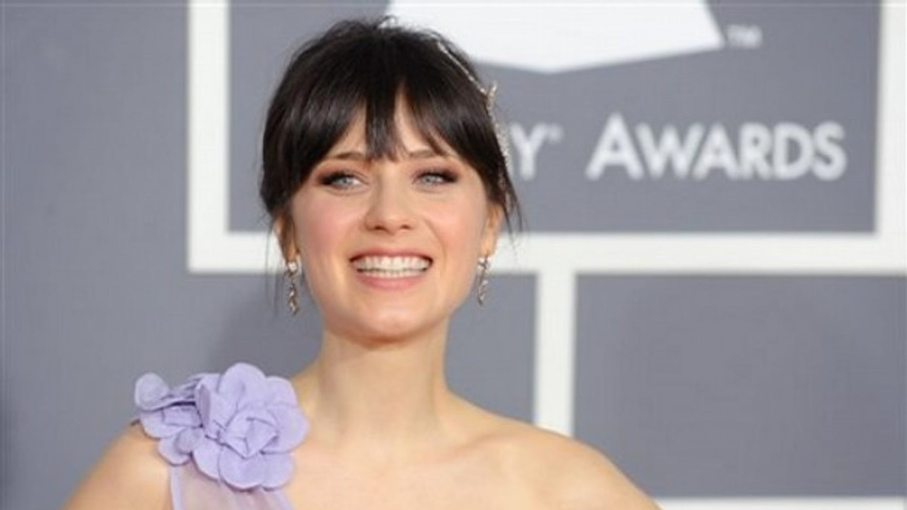 Zooey Deschanel arrives at the 51st Annual Grammy Awards on Sunday, Feb. 8, 2009, in Los Angeles. (AP Photo/Chris Pizzello)