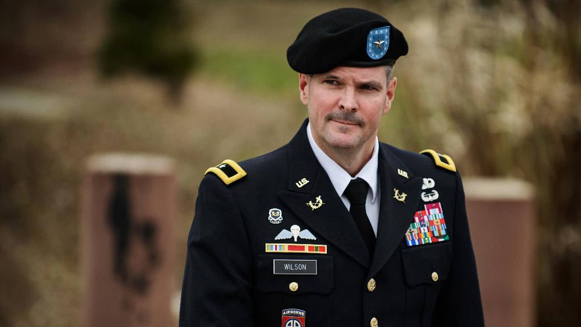 Brig. Gen. Paul Wilson leaves the courthouse after testifying in pretrial motions in the case of Brig. Gen. Jeffrey Sinclair, Tuesday, March 4, 2014, at Fort Bragg, N.C. Less than a month before Sinclair's trial on sexual assault charges, the lead prosecutor broke down in tears Tuesday as he told a superior he believed the primary accuser in the case had lied under oath. (AP Photo/The Fayetteville Observer, James Robinson)