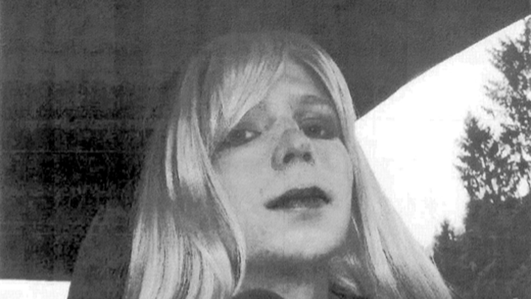 In this undated file photo provided by the U.S. Army, Pfc. Bradley Manning, now known as Chelsea Elizabeth Manning, poses for a photo wearing a wig and lipstick.
