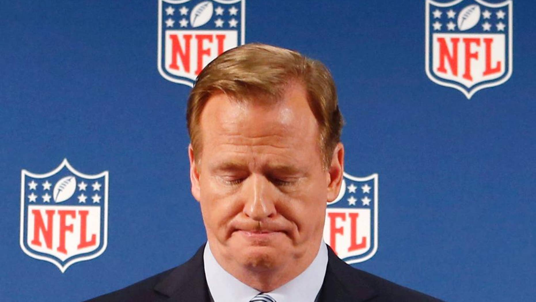 "FILE - In this Sept. 19, 2014, file photo, NFL Commissioner Roger Goodell pauses as he speaks during a news conference in New York.  Rice has won the appeal of his indefinite suspension by the NFL, which has been ""vacated immediately,"" the players' union said Friday, Nov. 28, 2014. (AP Photo/Jason DeCrow, File)"