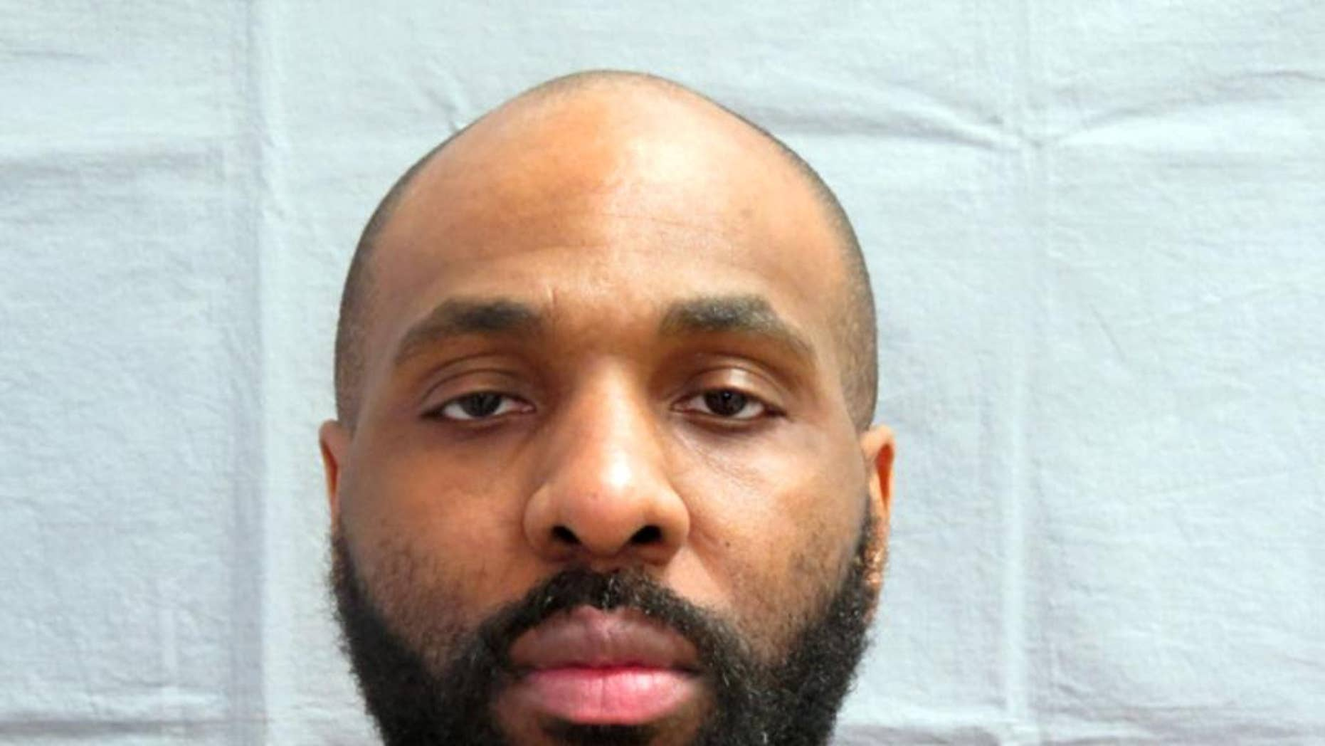 In this photo taken on March 30, 2013 provided by the Michigan Department of Corrections, Nosakhare Onumonu appears in a booking mug. A unique glove and a DNA match helped lead to a conviction in the 1999 slaying of an 84-year-old woman whose body was found in an alley behind a church on Detroit's west side, authorities said. A report in the Detroit Free Press details the case that led to Onumonu being convicted of first-degree murder and felony murder. The 38-year-old man is scheduled to be sentenced Friday, Aug. 21, 2015,  to the mandatory term of life in prison without the possibility of parole. (Michigan Department of Correction via AP)