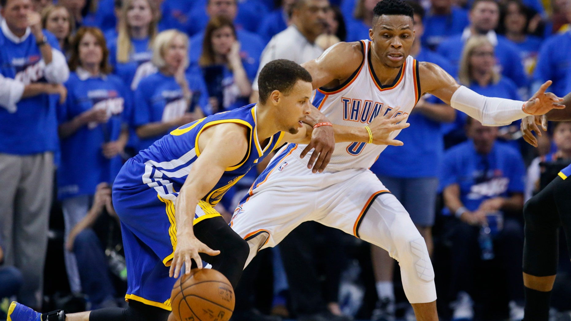 May 22, 2016: Golden State Warriors guard Stephen Curry (30) tries to drive around Oklahoma City Thunder guard Russell Westbrook (0) during the second half in Game 3 of the NBA Western Conference finals in Oklahoma City