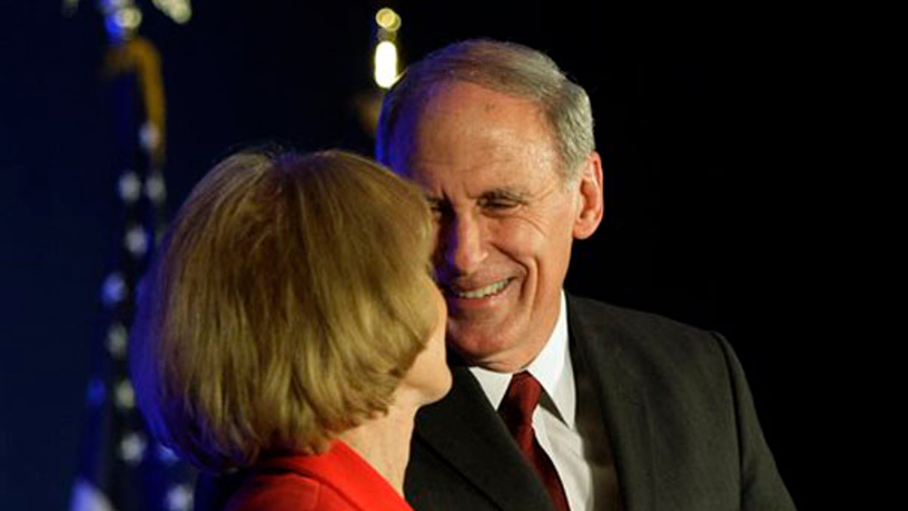 Sen. Dan Coats is greeted by his wife, Marsh, in Indianapolis.