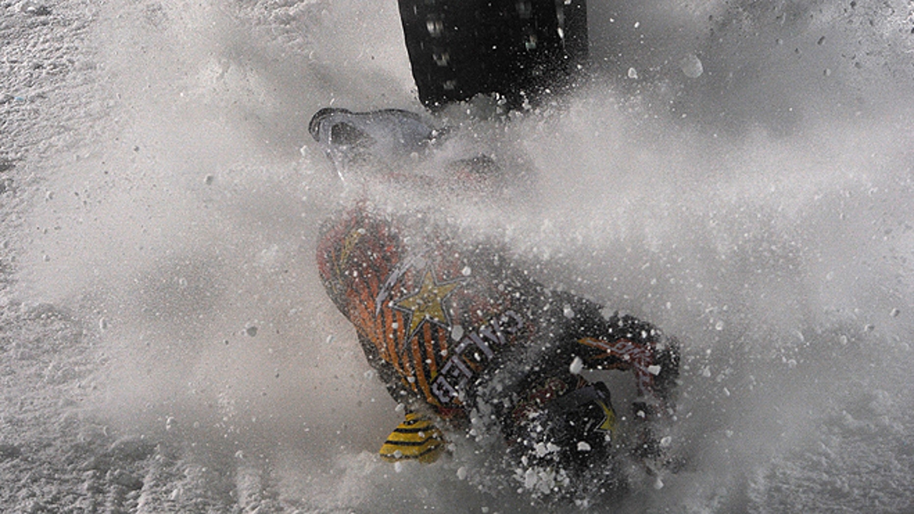 Jan. 24, 2013: Caleb Moore crashes during the snowmoblie freestyle finals during the first day of the X Games Aspen 2013. The Competition runs through Sunday at Aspen's Buttermilk.  (AP)