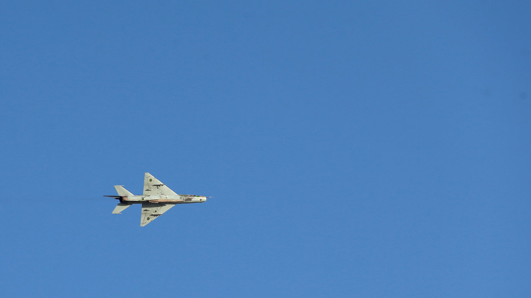A warplane belonging to Libyan pro-government forces, who are backed by the locals, attempts to bomb sites under the Shura Council of Libyan Revolutionaries, an alliance of former anti-Gaddafi rebels who have joined forces with the Islamist group Ansar al-Sharia, during clashes in Libya April 27, 2016. (REUTERS/Esam Omran Al-Fetori)