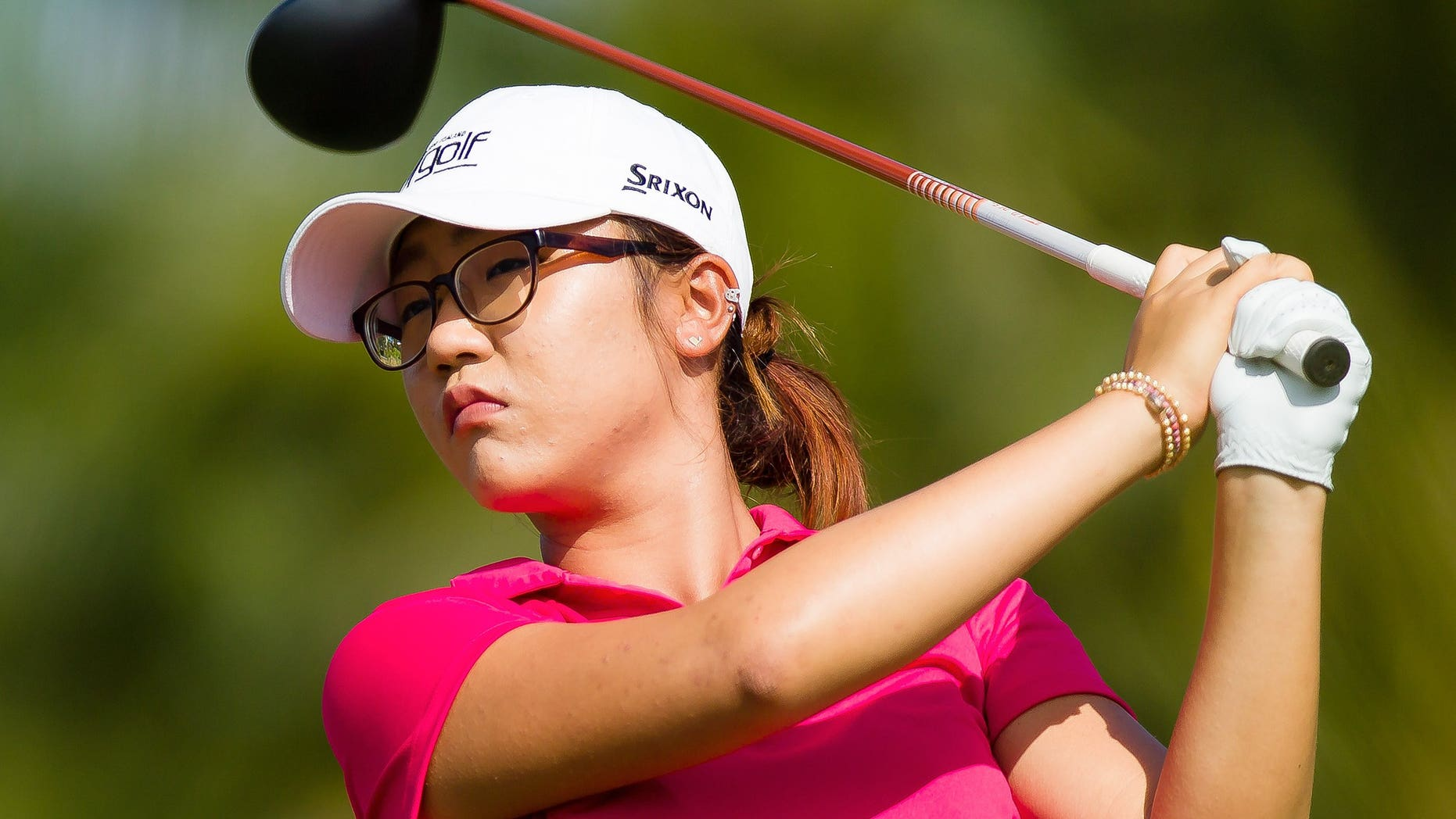 In this photo taken on Tuesday, Nov. 19, 2013, Lydia Ko, of New Zealand, hits a tee shot during the pro-am of the LPGA Titleholders golf tournament at the Tiburon Golf Club in Naples, Fla. (AP Photo/Naples Daily News, David Albers)  FORT MYERS OUT, TV OUT, MAGS OUT