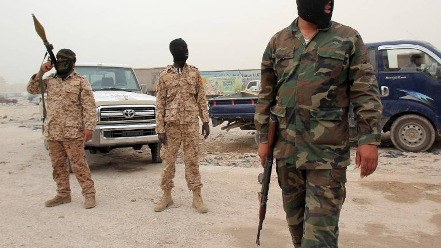 Members of the Libyan Rapid intervention force unit patrol at a checkpoint in Benghazi on May 16, 2013
