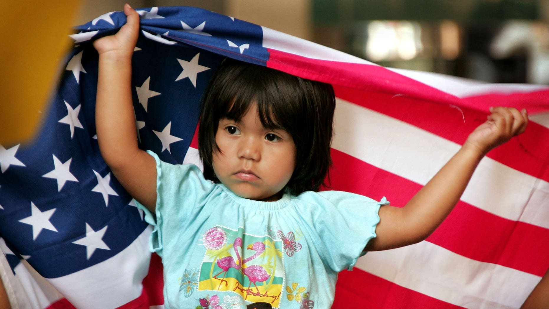 CHICAGO - JULY 31:  Ana Sari, 3, sits on her father's shoulders as they demonstrate outside the building that houses immigration court along with family and friends of IFCO System employees as they await word on the deportation hearings July 31, 2006 in Chicago, Illinois. Twenty-six illegal immigrants were arrested in April in Chicago during a nationwide sweep of undocumented workers at IFCO Systems. All fifteen of the Chicago IFCO Systems employees who appeared in court today were granted a one year extension in their cases.  (Photo by Scott Olson/Getty Images)