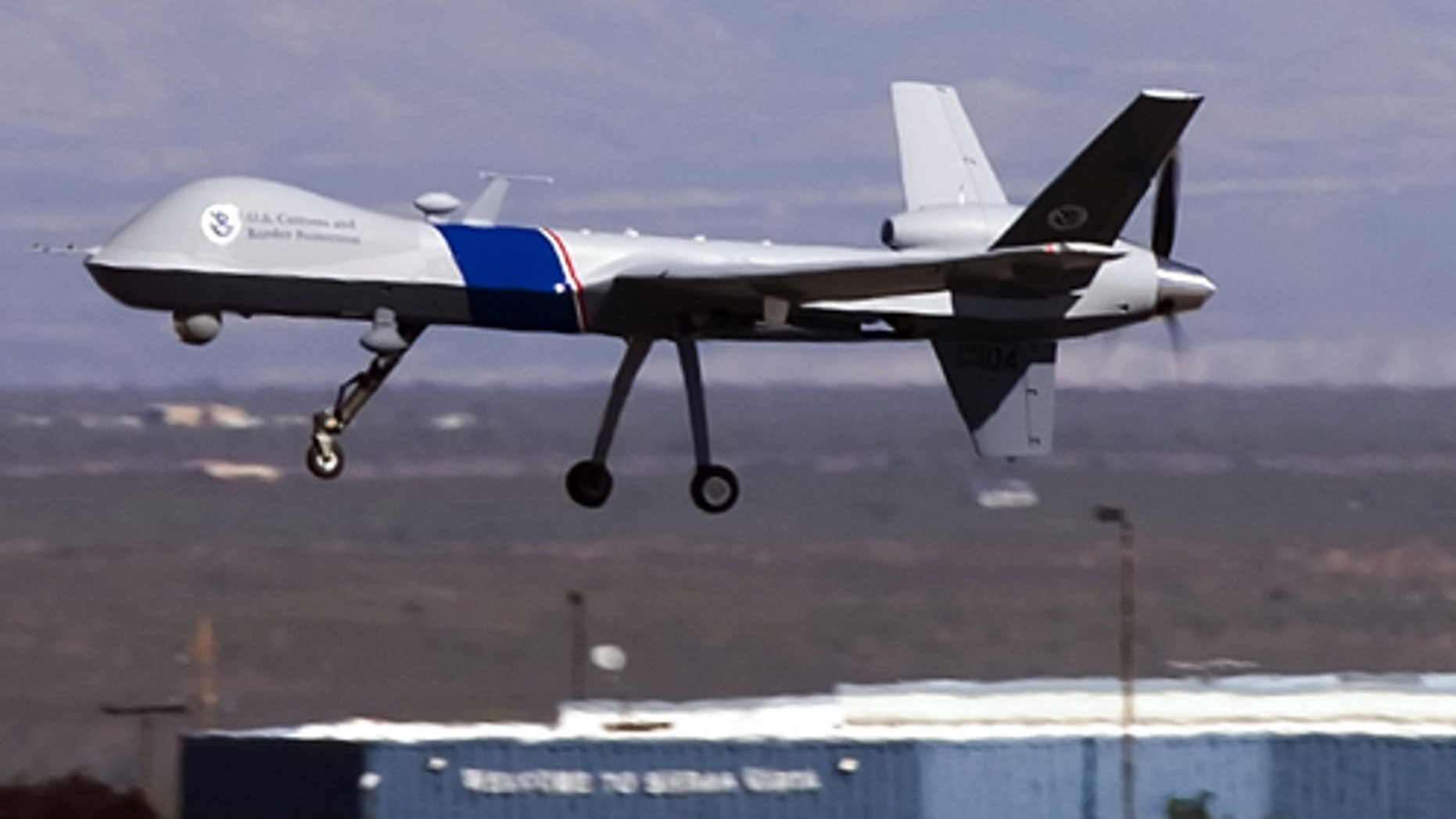 SIERRA VISTA, AZ - OCTOBER 30:  The new MQ-9 Predator B, an unmanned surveillance aircraft system, unveiled by the U.S. Customs and Border Protection (CBP), takes off at Libby Army Airfield at Ft. Huachuca October 30, 2006 in Sierra Vista, Arizona. CBP will use the new MQ-9 Predator aircraft to patrol the southern border of the United Sates in order to stop the illegal entry of thousands of Mexican nationals and drug runners who use the vast expanses of the Sonoran desert to cross into southern Arizona, daily. The new unarmed plane flew briefly for the press to show off its surveillance  capabilities by pilots of the contractor, General Atomics Aeronautical Systems. Agents of CBP will start training on the use of the aircraft very soon. The Predator will start full scale flight operations along the Mexico-Arizona border today.  (Photo by Gary Williams/Getty Images)
