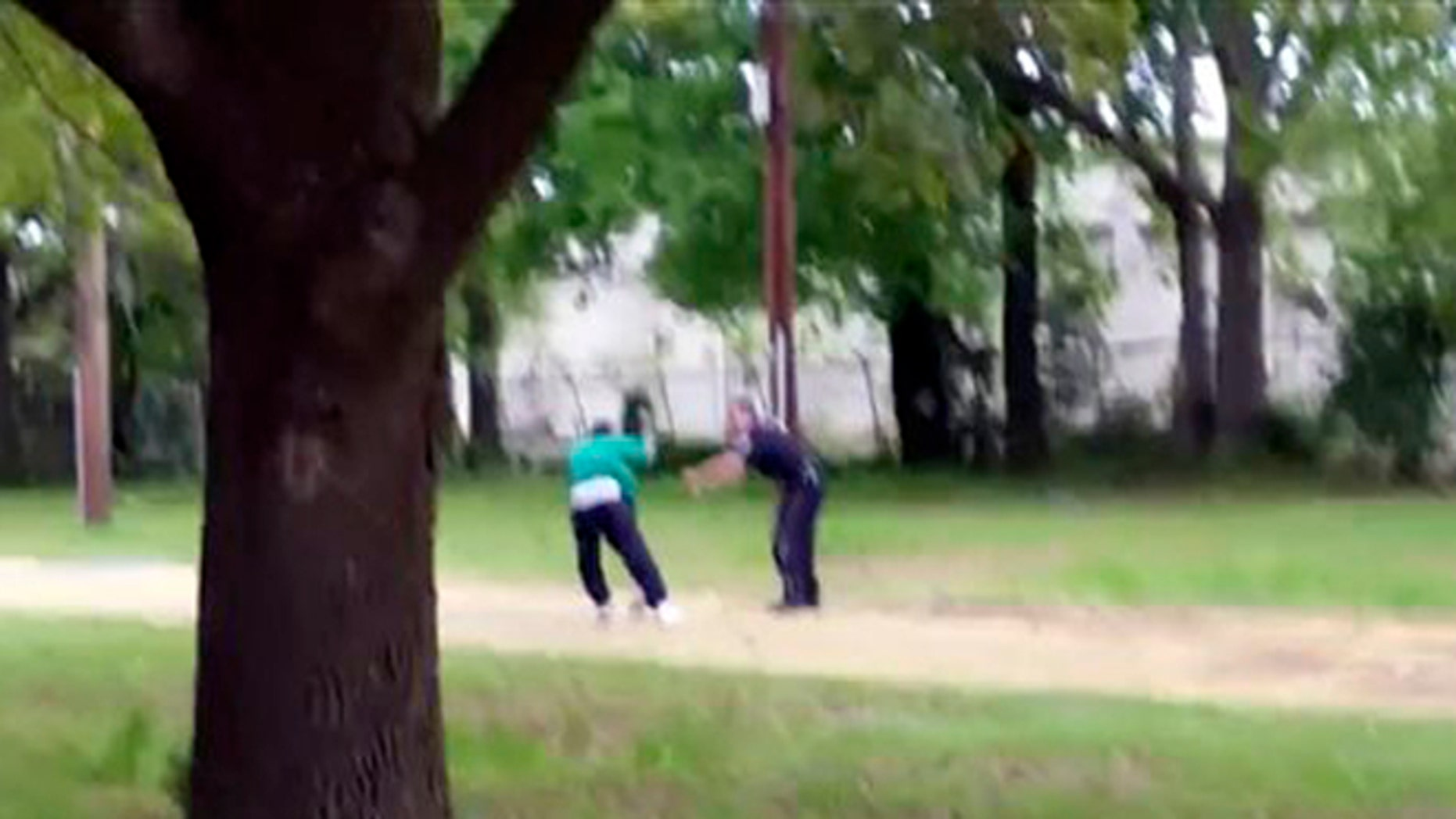 In this image from video, Walter Scott struggles with police officer Michael Thomas Slager in Charleston, S.C., on April 4, 2015. Moments later, the video shows Slager firing eight shots at Scott's back. Scott's death was shown around the world and he became a symbol of the ongoing debate over police shootings of unarmed African-Americans. (Feidin Santana via AP Images)