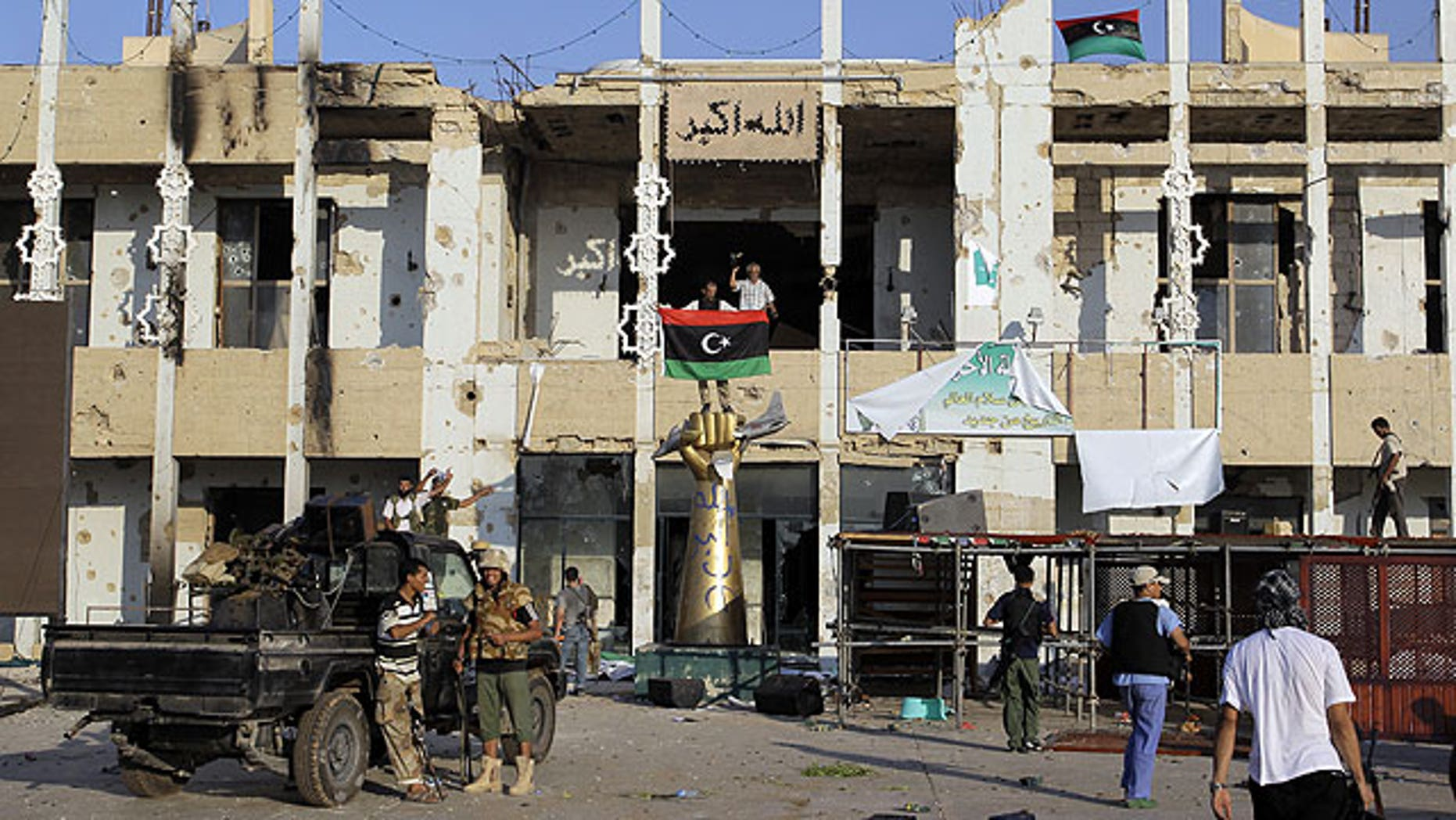 August 23: Rebel fighters seen inside the main Muammar Qaddafi compound in Bab al-Aziziya in Tripoli, Libya.
