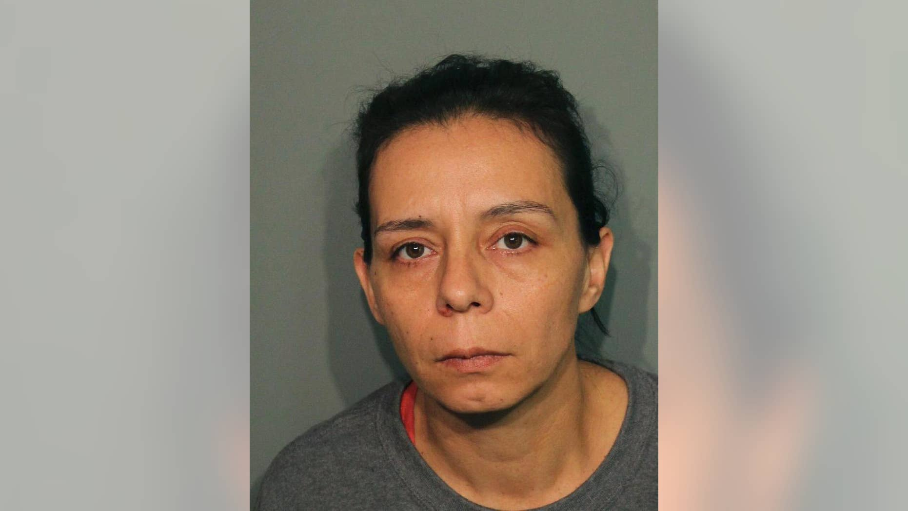 This booking photo released Wednesday, Sept. 21, 2016, by the Calaveras County Sheriff's Office shows Guadalupe Sierra Arrellano in San Andreas, Calif. Arrellano is one of two women arrested on charges of holding multiple men captive at an illegal marijuana plantation in Northern California and forcing them to work there for several months. Calaveras County Sheriff's Capt. Jim Macedo said Wednesday the men fled the secluded, rural camp in July after overhearing they would be murdered after the harvest. (Calaveras County Sheriff's Office via AP)