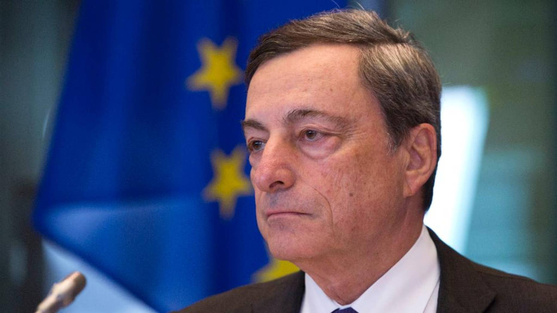 FILE - In this Monday, Sept. 26, 2016 file photo, Governor of the European Central Bank Mario Draghi pauses during a session of the Economic and Monetary Affairs Committee at the European Parliament in Brussels. Investors will sift European Central Bank head Mario Draghi's remarks on Thursday, Oct. 20. 2016 for clues about a possible extension of its 1.74 trillion euro ($1.91 trillion) bond-buying stimulus program. (AP Photo/Virginia Mayo, File)