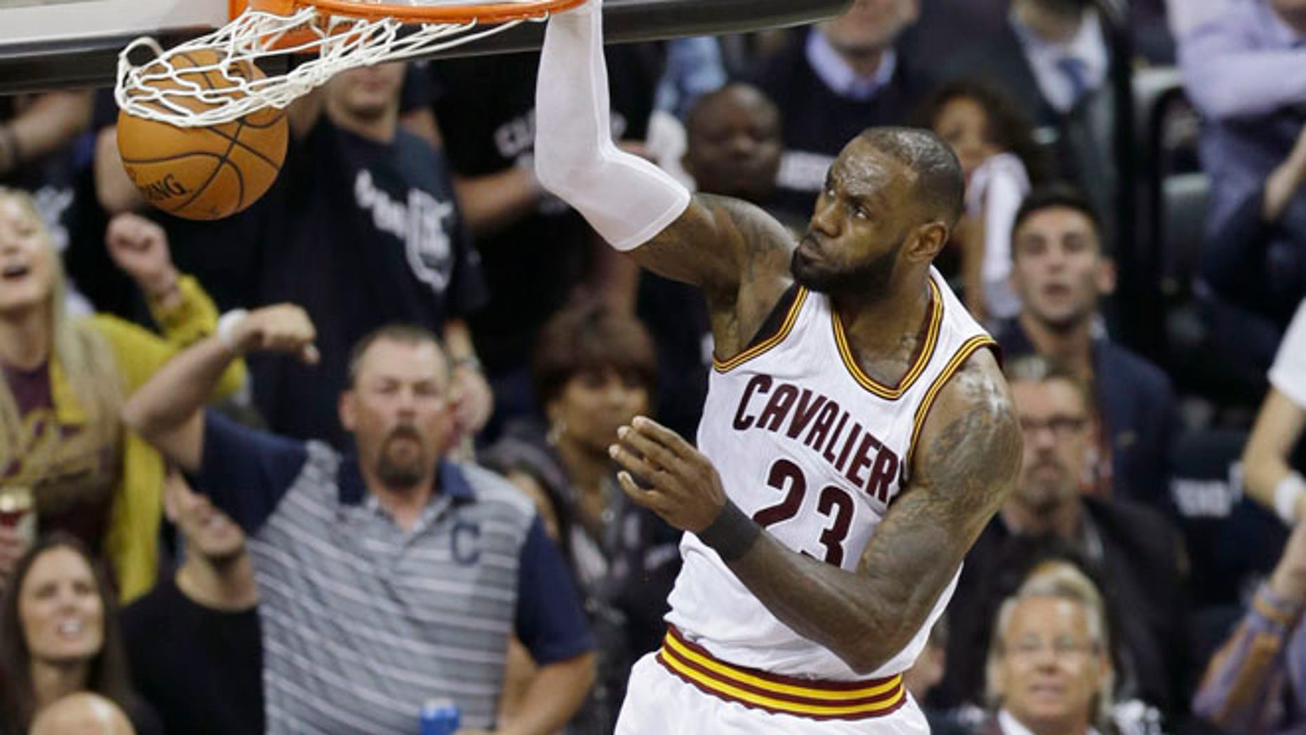 Cleveland Cavaliers forward LeBron James dunks against the Golden State Warriors during the first half of Game 4 of basketball's NBA Finals in Cleveland.