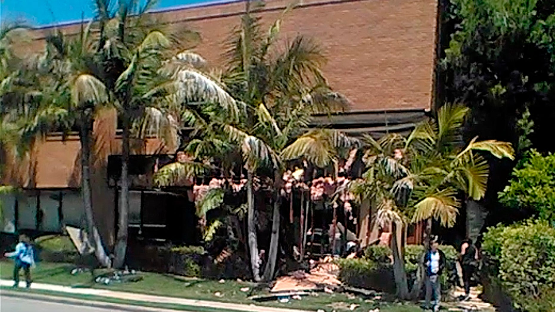 This image taken from cellphone video shows a building after a fatal explosion in Aliso Viejo, Calif., Tuesday, May 15, 2018. The cause of the blast is being investigated.