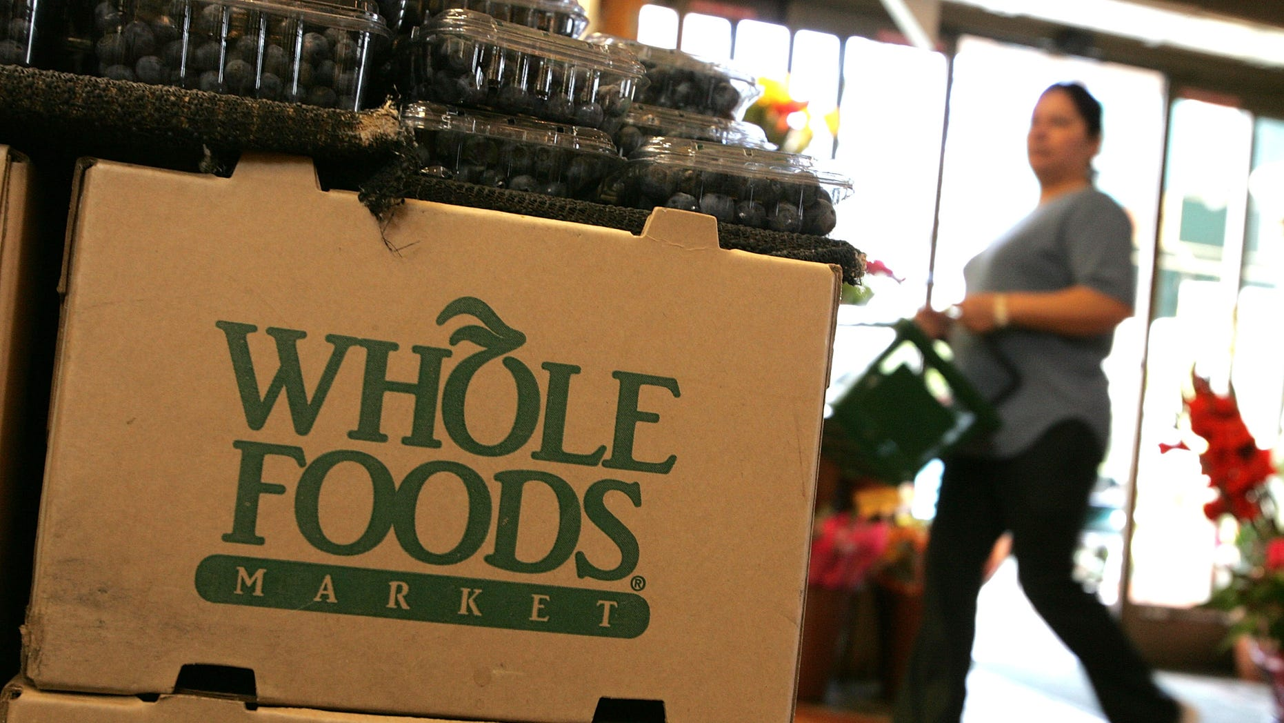 SAN FRANCISCO - FEBRUARY 22:  The Whole Foods logo adorns a cardboard box at a Whole Foods Market February 22, 2007 in San Francisco, California. Whole Foods Market Inc. announced that it plans to purchase Wild Oats Market Inc. for an estimated $565 million in hopes of competing with larger food chains that have started to introduce organic and prepared foods to their inventories.  (Photo by Justin Sullivan/Getty Images)