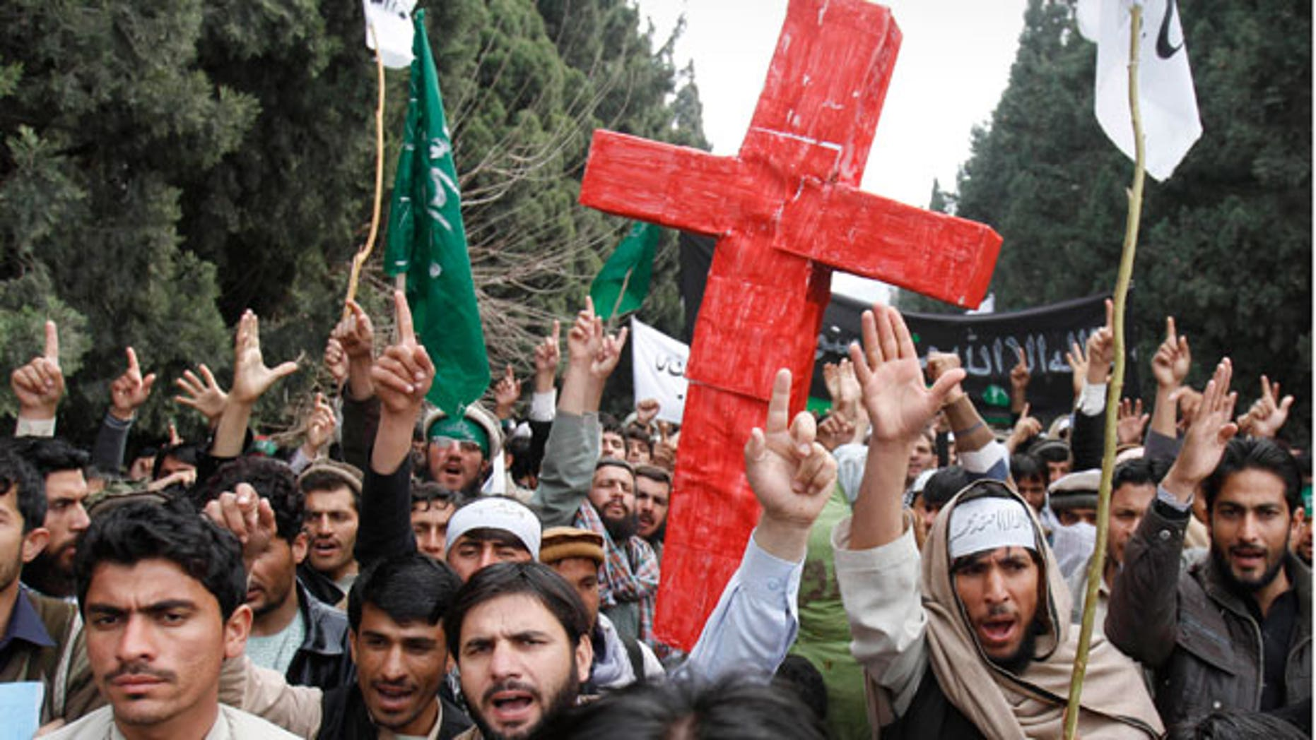 Mar. 13, 2012: Demonstrators chant anti U.S. slogans as they carry a red cross following Sunday's killing of civilians in Panjwai, Kandahar by a U.S. soldier during a protest in Jalalabad east of Kabul, Afghanistan.