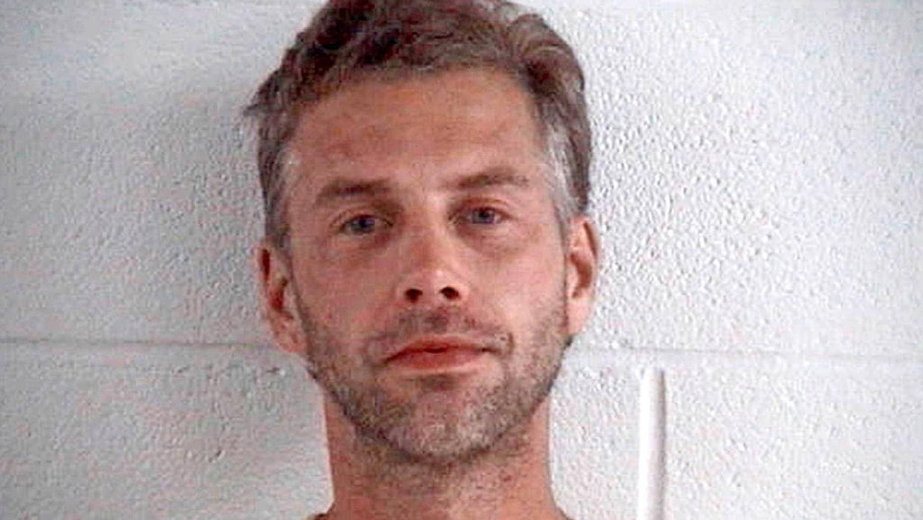 FILE – This file photo provided by the Ashland County Sheriff Office shows Shawn Grate, arrested Sept. 13, 2016, in Ashland, Ohio. Authorities in Ohio have identified the remains of a woman whose death has been connected to Grate, suspected in the killings of at least three other women. A coroner identified the woman whose body was found in September near Mansfield as Candice Cunningham. Media reports say she had been living with Shawn Grate this past summer.(Ashland County Sheriff Office via AP, File)