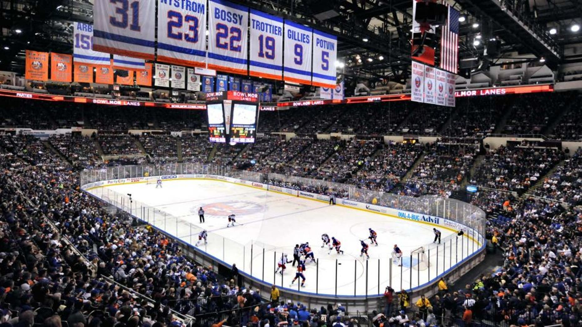 This April 11, 2015 file photo show the New York Islanders play against the Columbus Blue Jackets in the first period of the Islanders last regular season home game at the Nassau Veterans Memorial Coliseum, in Uniondale, NY. For loyal fans of the Islanders, this yearís playoff run is tinged with even more of a sense of finality, and yes, sadness. Win or lose, these will be the last games for Long Islandís only major pro sports franchise, which will move to Brooklyn at the end of the season. (AP Photo/Kathy Kmonicek, File)