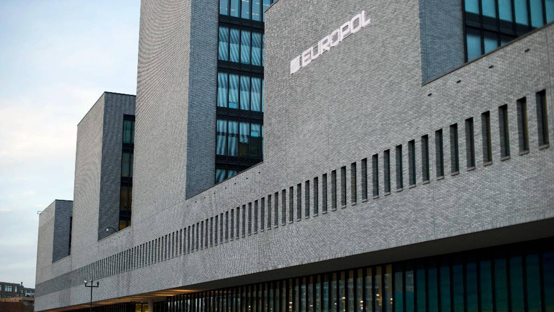 "FILE - In this Jan. 16, 2015 file photo a man walks past the European police agency Europol in The Hague, Netherlands. European Union officials are seeking sweeping changes in bloc policies and practices to face new security risks arising from terrorism, organized crime and cybercrime. EU Commission vice president Frans Timmermans said Tuesday April 28, 2015 there is still too much ""mistrust and reticence to cooperate"" among European countries. (AP Photo/Peter Dejong, File)"
