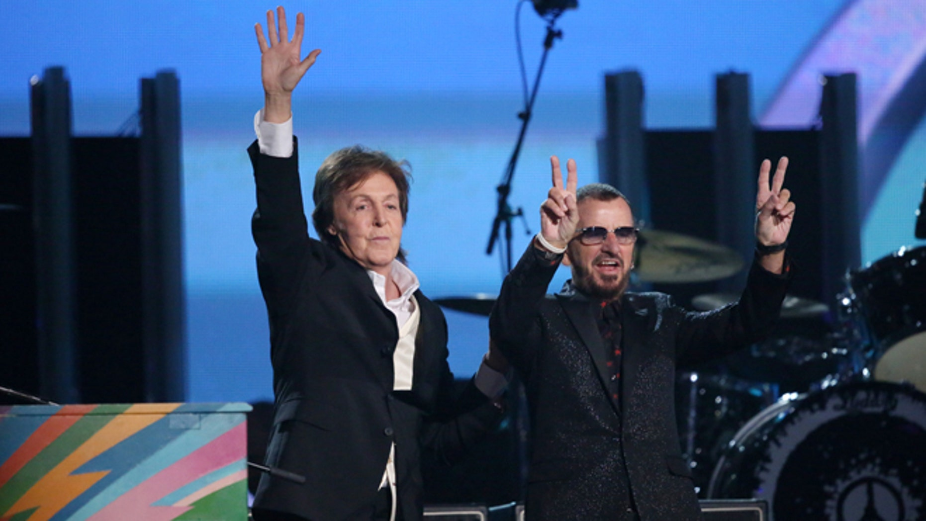 Paul McCartney, left, and Ringo Starr perform on stage at the 56th annual Grammy Awards at Staples Center on Sunday, Jan. 26, 2014, in Los Angeles. (Photo by Matt Sayles/Invision/AP)