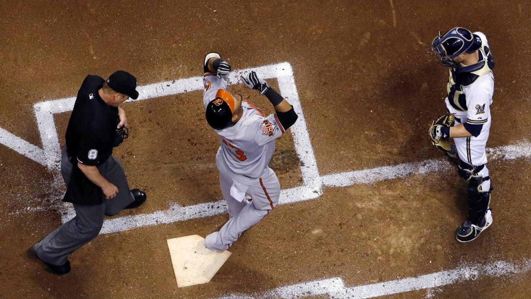 Baltimore Orioles' Nelson Cruz looks up as he crosses home after hitting a home run during the second inning of a baseball game against the Milwaukee Brewers on Wednesday, May 28, 2014, in Milwaukee. (AP Photo/Morry Gash)