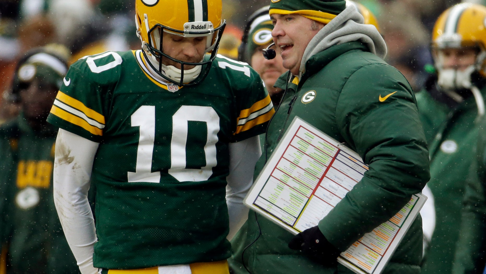 Green Bay Packers head coach Mike McCarthy talks to Matt Flynn (10) during the first half of an NFL football game against the Atlanta Falcons Sunday, Dec. 8, 2013, in Green Bay, Wis. (AP Photo/Mike Roemer)