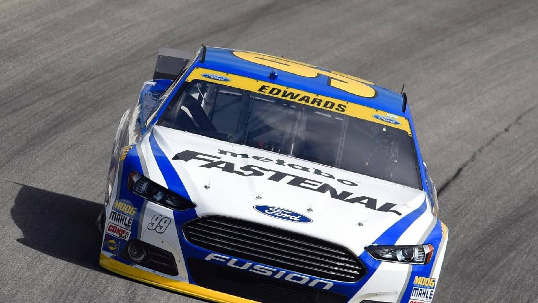 NASCAR driver Carl Edwards (99) drives during a practice for the NASCAR Sprint Cup Series auto race at Chicagoland Speedway in Joliet, Ill., Saturday, Sept. 13, 2014. (AP Photo/Paul J. Bergstrom)