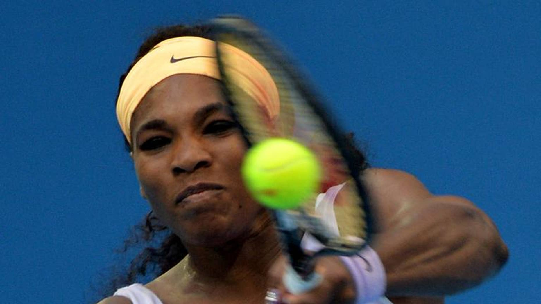 Serena Williams plays a shot during her match against Francesca Schiavone at the China Open in Beijing on October 1, 2013
