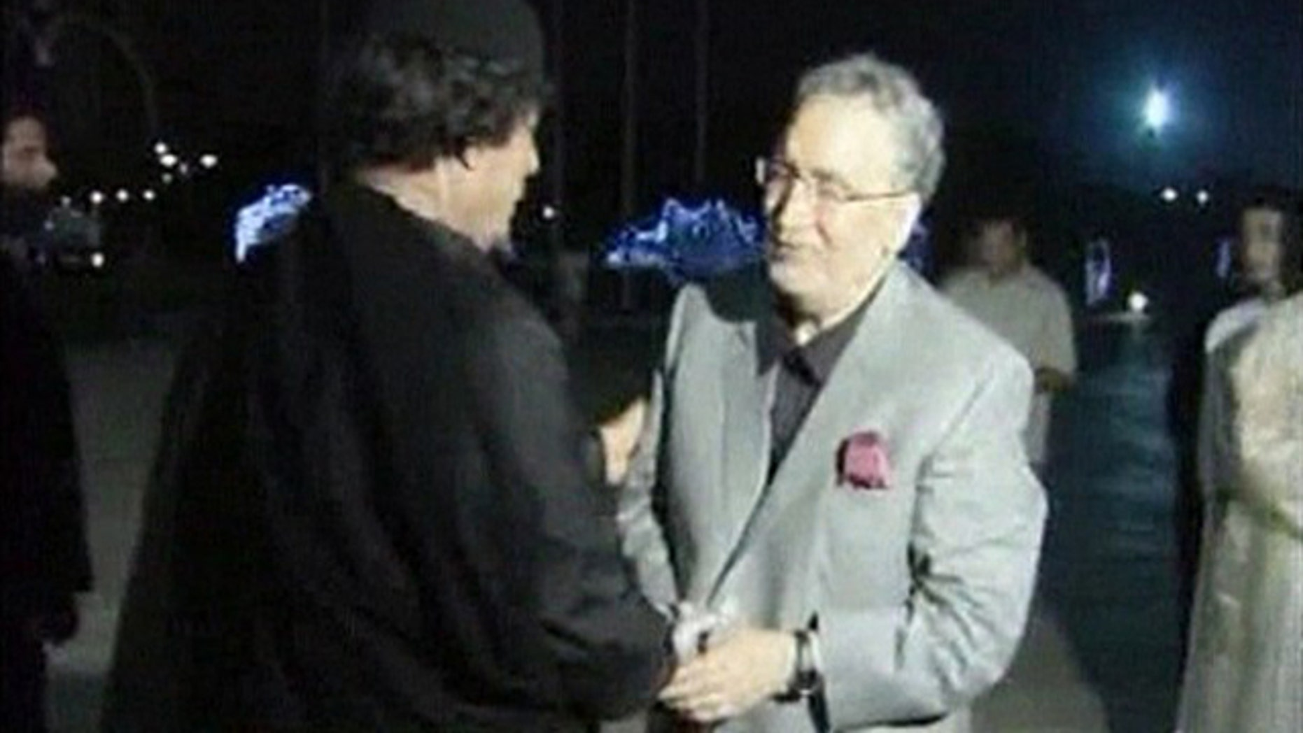 Aug. 21, 2009: Convicted Lockerbie bomber Abdelbaset al-Megrahi shakes the hand of Libyan leader Muammar Qaddafi in Tripoli in this image from Libya TV. (Reuters)