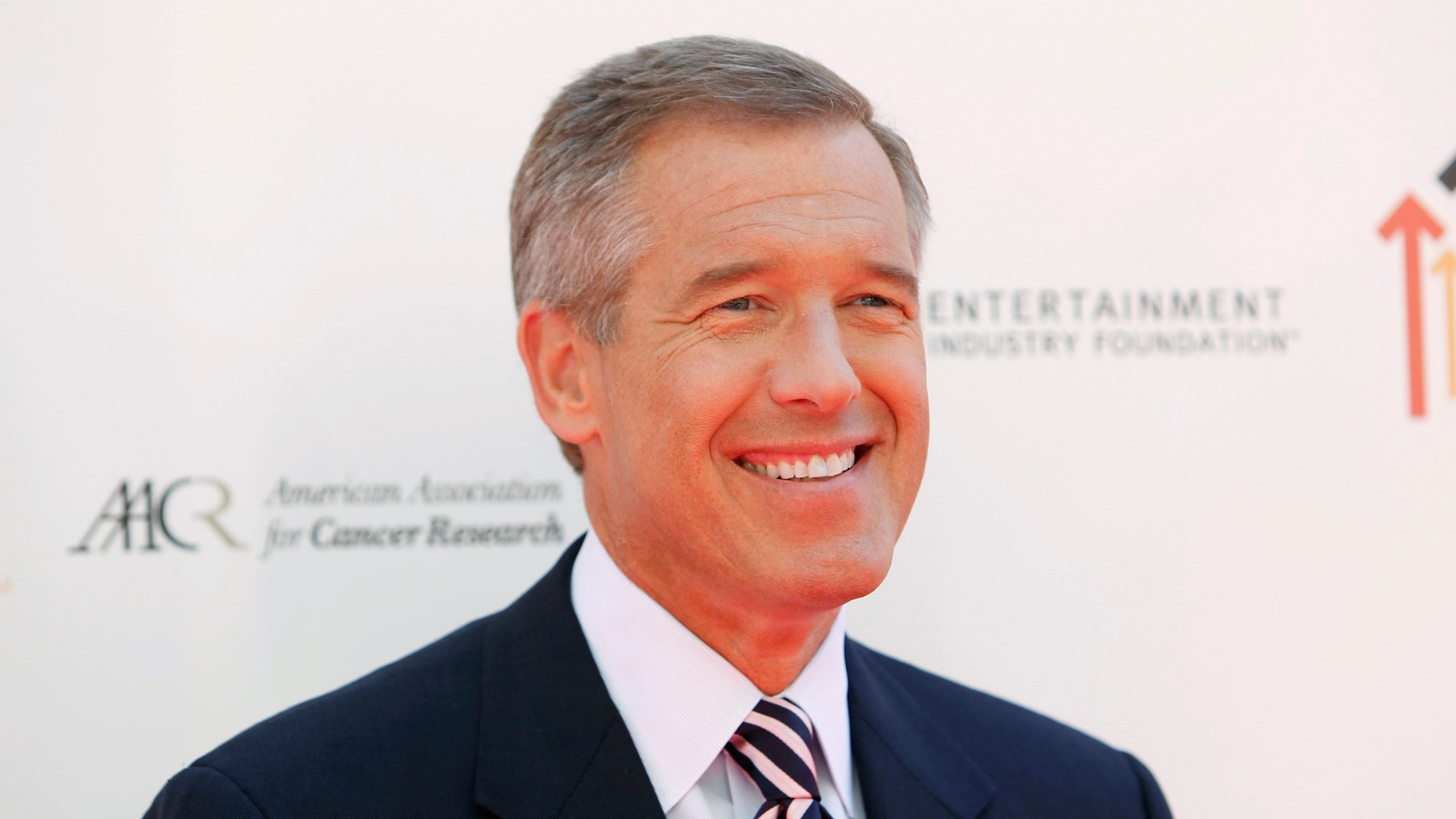 """NBC news anchor Brian Williams poses at the """"Stand Up To Cancer"""" television event, aimed at raising funds to accelerate innovative cancer research, at the Sony Studios Lot in Culver City, California September 10, 2010."""