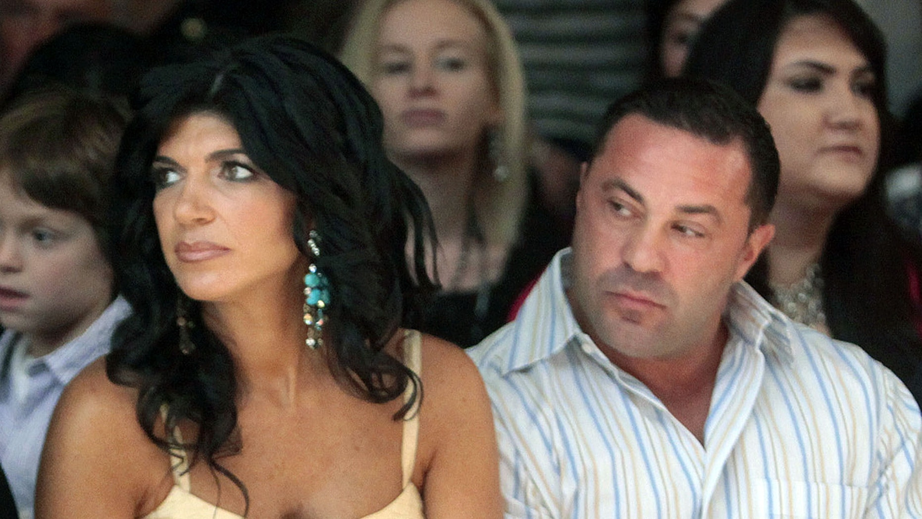 """This Sept. 13, 2009 file photo originally released by Oral-B Pulsonic shows """"Real Housewives of New Jersey"""" stars, Teresa Giudice, left, and her husband Joe Giudice at the Caravan Fashion Show in New York. Teresa and Giuseppe """"Joe"""" Giudice were charged in a 39-count indictment handed up Monday, July 29, 2013, in Newark, N.J."""