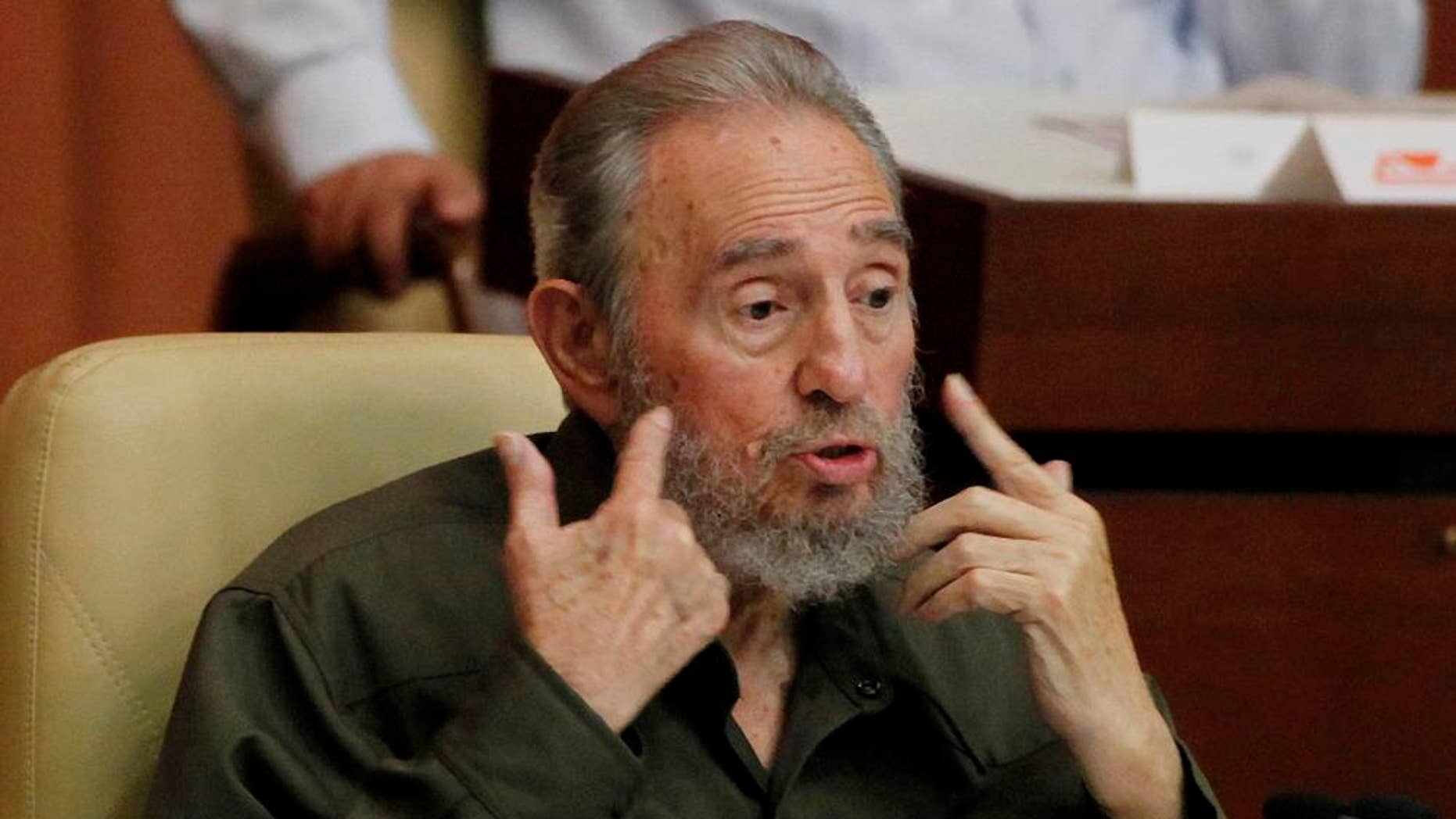 Fidel Castro speaks at a special session of parliament in his first official government appearance in front of lawmakers in four years in Havana, Cuba, Saturday Aug. 7, 2010. Castro, who turns 84 on Aug. 13, is making near daily appearances in and around Havana, after spending four years almost completely out of the public eye following emergency intestinal surgery that forced him to cede power to his younger brother Raul.  (AP Photo/Javier Galeano)